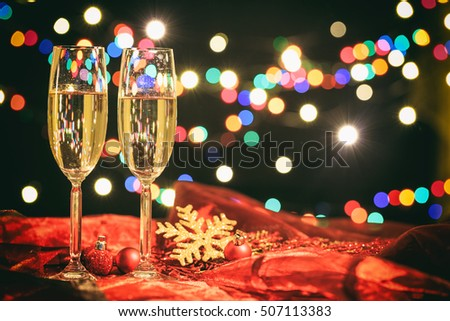 Two glasses of champagne and christmas decoration