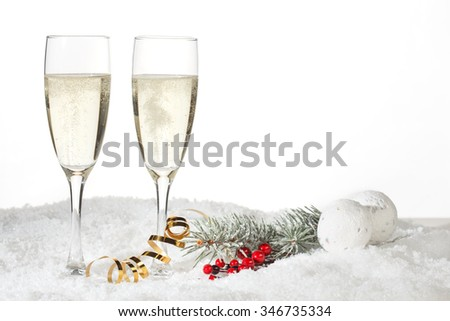 Two glasses of champagne in the snow - stock photo