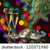 Two glasses of champagne, mask and New Year decoration - stock photo