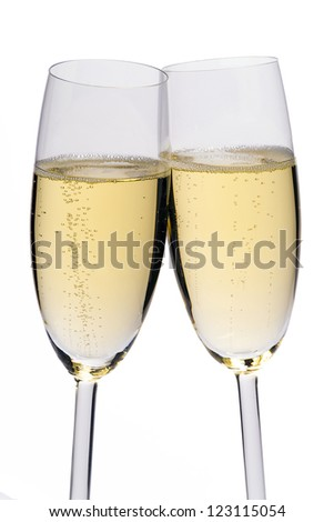 Two glasses of champagne on white background - stock photo