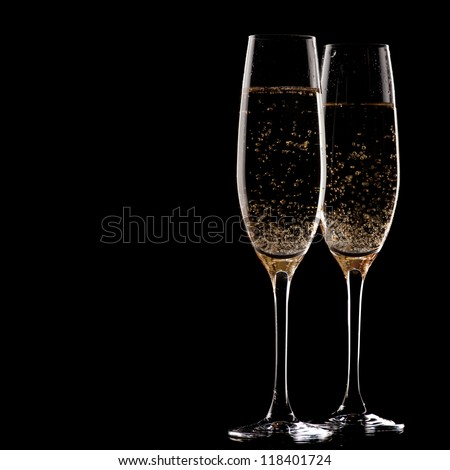 two glasses of champagne over black background - stock photo