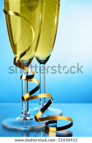 Two glasses of champagne with space for your own text on left - stock photo