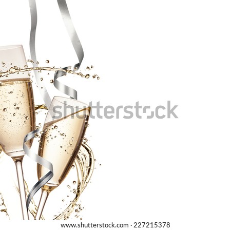 Two glasses of champagne with splash, isolated on white background - stock photo