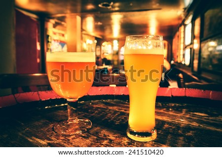 Two glasses of fresh beer  - stock photo