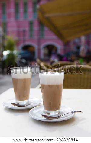 Two glasses of latte macchiato in a cafe in Caorle, Italy - stock photo