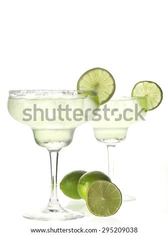 Two glasses of margarita cocktail on a white background.