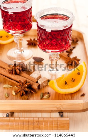 Two glasses of mulled wine and spices