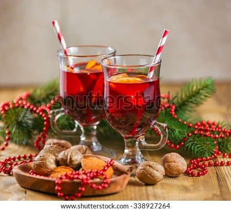 Two glasses of mulled wine for Christmas and winter holidays on the wooden table. - stock photo