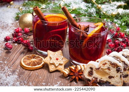 Two glasses of  mulled wine with christmas decoration - stock photo