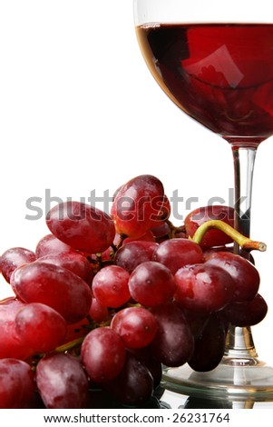 Two glasses of red wine and grapes isolated over white background
