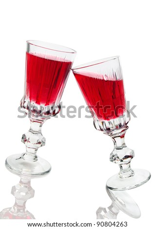 Two glasses of red wine isolated on a white background - stock photo