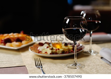 two glasses of red wine on the background of the dishes in the restaurant - stock photo