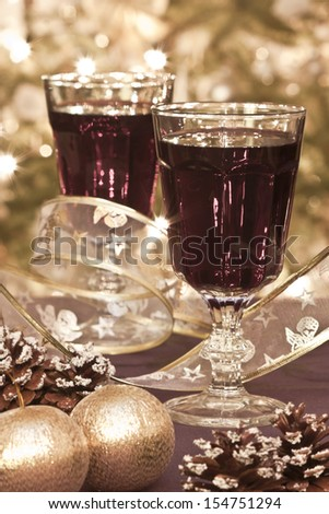 Two glasses of red wine with decoration - stock photo