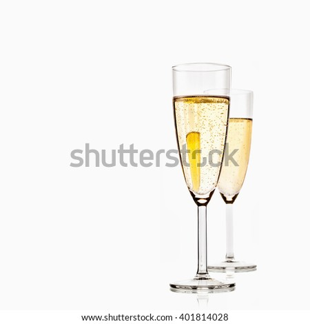 two glasses of sparkling champagne isolated on white