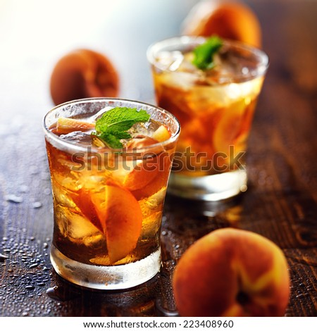 two glasses of sweet peach iced tea - stock photo