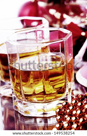two  glasses of whiskey and Christmas decoration  - stock photo
