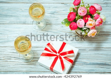 Two glasses white wine flowers gift stock photo royalty free two glasses of white wine flowers and a gift flat lay mightylinksfo