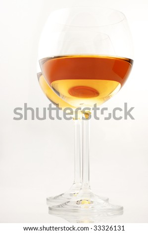 Two glasses of white wine on white background.