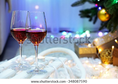 Two glasses of wine on christmas decor background - stock photo