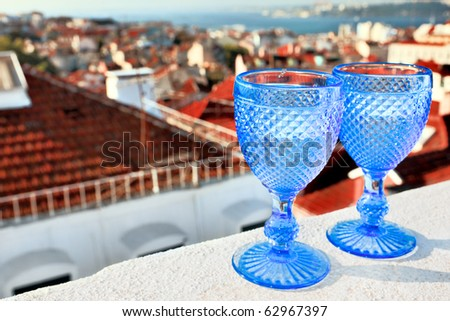 Two glasses of wine on the roof of the town.
