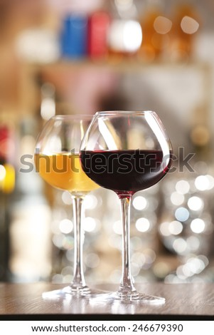 Two glasses of wine with bar on background - stock photo