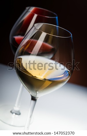 Two glasses of wine with nice reflection - stock photo