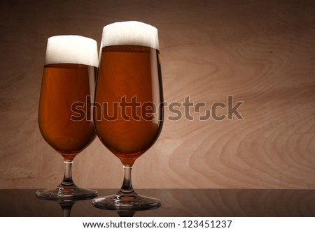 Two glasses with beer served on the table