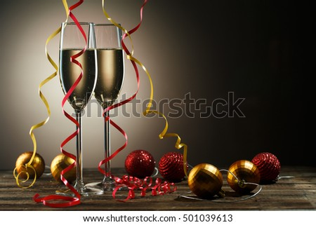 Two glasses with champagne and Christmas decoration ball