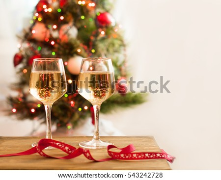 Two glasses with champagne for two on holiday, white wine in the glass, romantic relationships, love