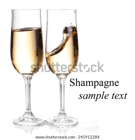 Two glasses with champagne. Isolated on white with clipping path.(with sample text) - stock photo
