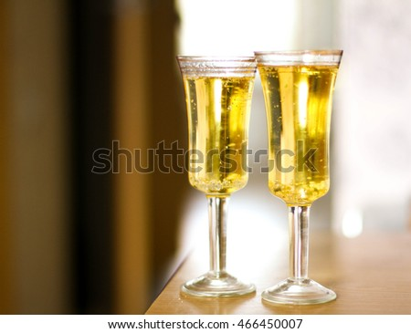 Two glasses with champagne on the table