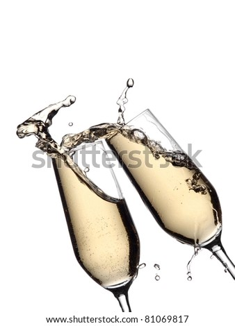 Two glasses with champagne splash - stock photo