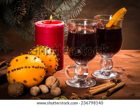 Two glasses with mulled wine on Christmas background - stock photo