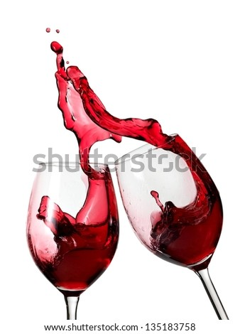 Two glasses with red wine splash - stock photo