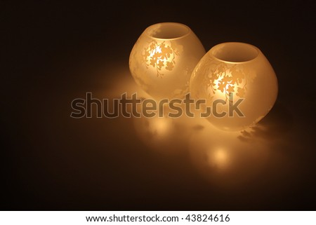 Two globe lights with a cherry blossom design. - stock photo