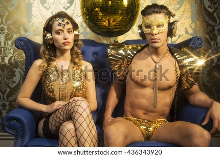 Two gold sexy disco characters