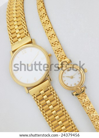 Two gold watches on white background - stock photo