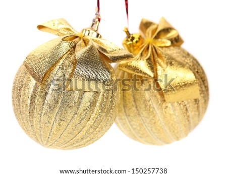 Two golden balls for the Christmas tree. - stock photo