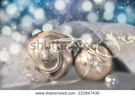 Two golden baubles on abstract winter background - stock photo