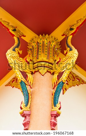 two golden bird pattern decorative roof suspension of thai temple.