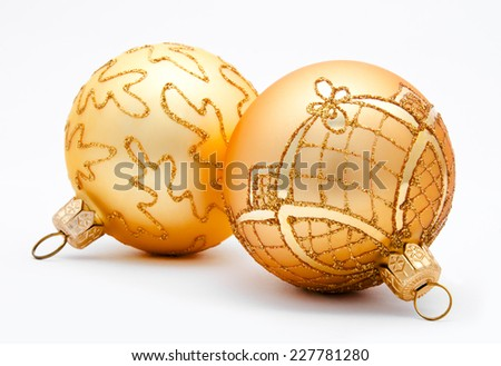 Two golden christmas balls isolated on a white background  - stock photo