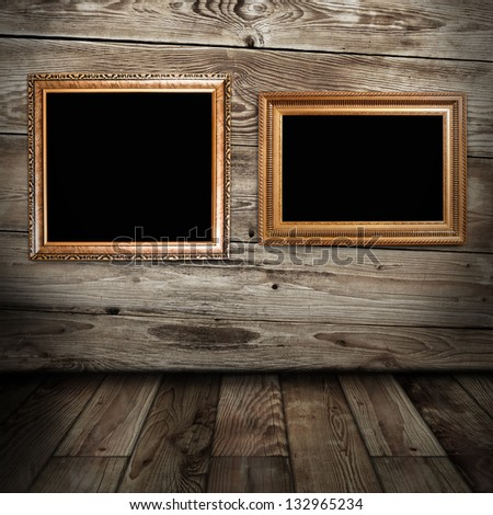 two golden frames in vintage room - stock photo