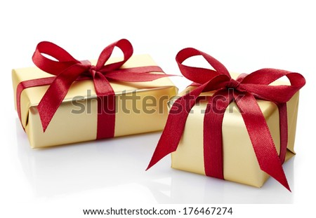 Two golden gift boxes isolated on white background
