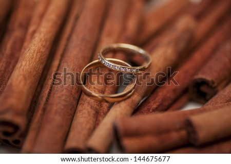two golden wedding rings on canella