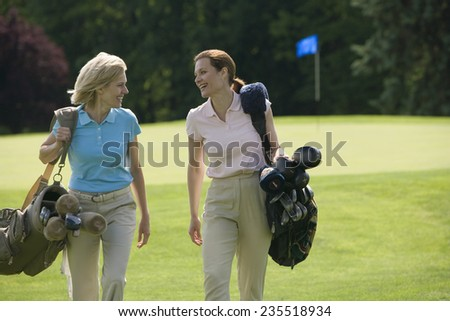 Two Golfers on Golf Course - stock photo