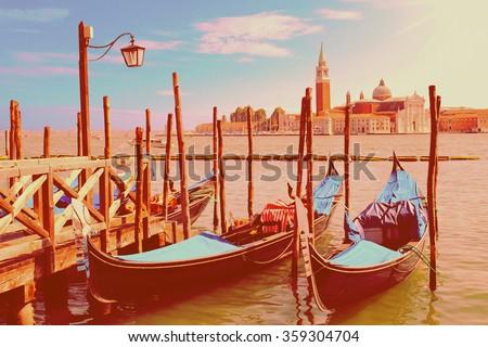 Two gondolas on the San Marco canal and Church of San Giorgio Maggiore in Venice, Italia in instagram style - stock photo
