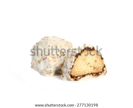 Two gourmet assorted white truffles hand made by chocolatier on white background. One truffle cut in half - stock photo