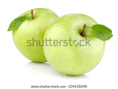 Two green apples with leaves and drops of water isolated on a white background - stock photo