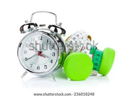 Two green dumbells, tape measure and alarm clock. Fitness and health. Isolated on white background - stock photo