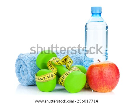 Two green dumbells, tape measure, apple and water bottle. Fitness and health. Isolated on white background